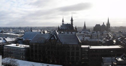 panoramic view of Aachen, including Kaiser Karls Gymnasium (foreground), townhall (back center) and cathedral (back right)